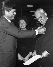 Kennedy presents the National Security Medal to Dulles, November 28, 1961.jpg