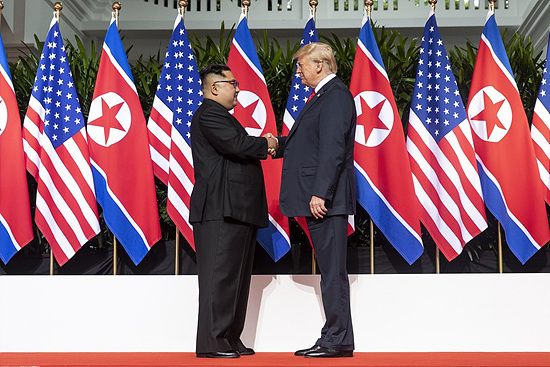 1280px-Kim_and_Trump_shaking_hands_at_the_red_carpet_during_the_DPRK–USA_Singapore_Summit.jpg